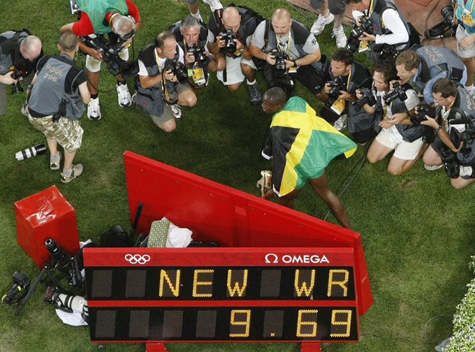 The Olympics as a media-constructed reality: Usain Bolt poses for photographers after winning the men's 100-metre final in Beijing 2008. REUTERS/Kim Kyung-Hoon