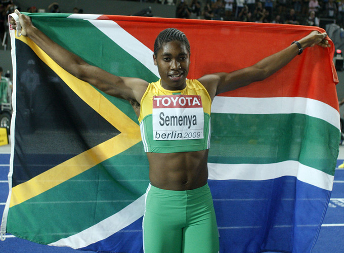 Caster Semenya celebrates after winning the women's 800-metres final during the World Athletics Championships at the Olympic stadium in 2009. REUTERS/Dominic Ebenbichler