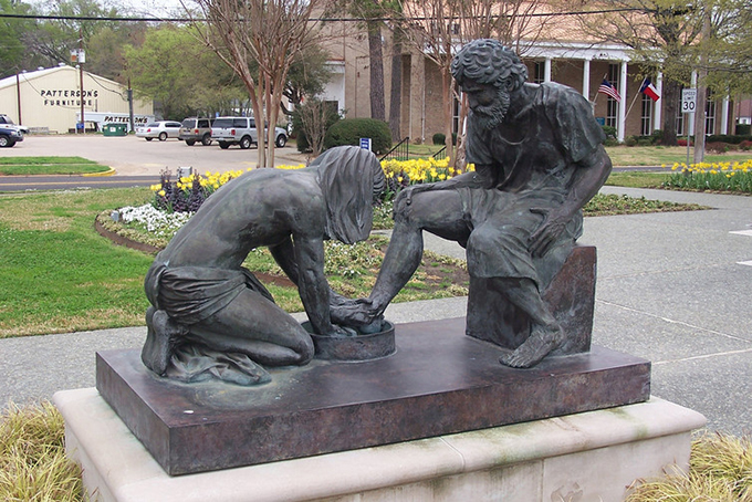 Jesus washing Peter's feet. Sculpture beside the Prayer Tower, Pittsburg, Texas. J. Stephen Conn