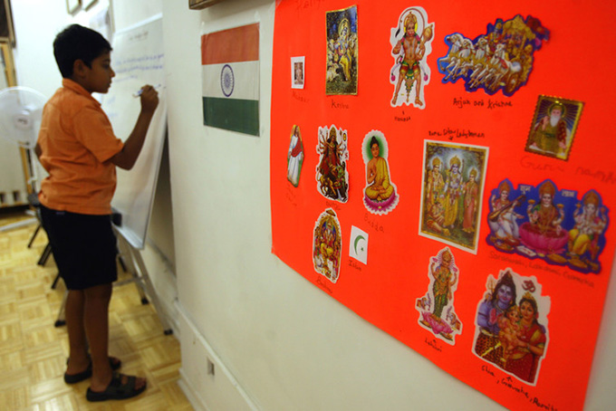 A poster displaying the religions of India at the India Heritage Camp held in New York. Mary Altaffer/AP