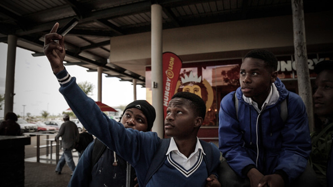 That's a pic to upload later … boys and their smartphones in Mdantsane, South Africa. UNICEF/Afhsin Rohani