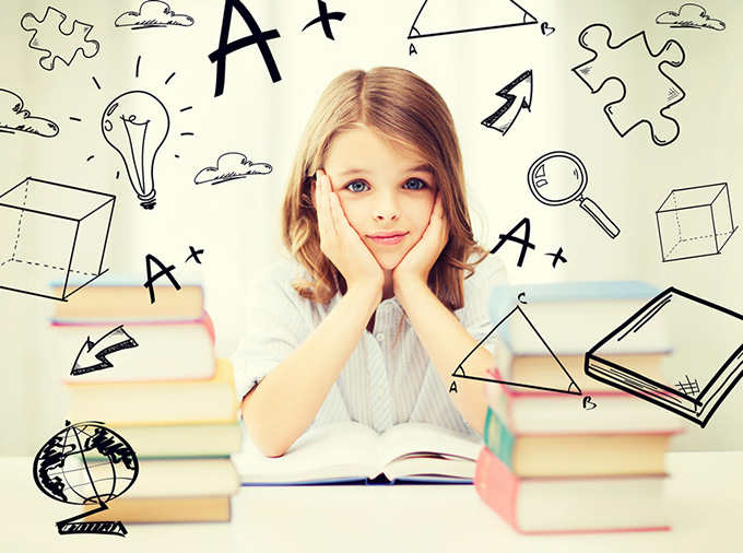 education and school concept - little student girl studying and
